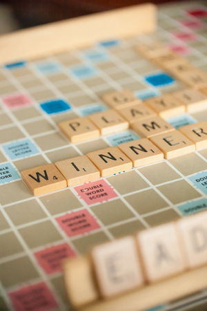 WOODBRIDGE, NEW JERSEY - October 9, 2018: A vintage Scrabble board game is shown with letter tiles Redactioneel