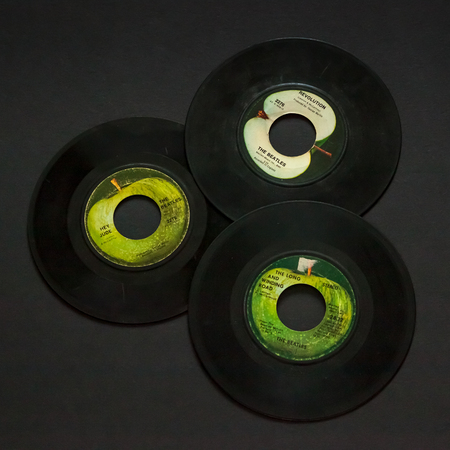 WOODBRIDGE, NEW JERSEY - October 11, 2018: A collection of 1960s Beatles 45 speed records including Hey Jude, Revolution, and the Long and Winding Road.