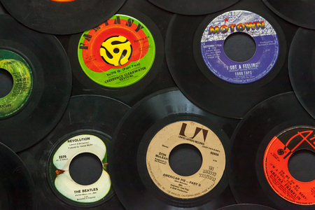 WOODBRIDGE, NEW JERSEY - October 11, 2018: A collection of 1960s 45 speed records, including the Beatles, Don McLean, Four Tops, Aretha Franklin, and Creedence Clearwater Revival.