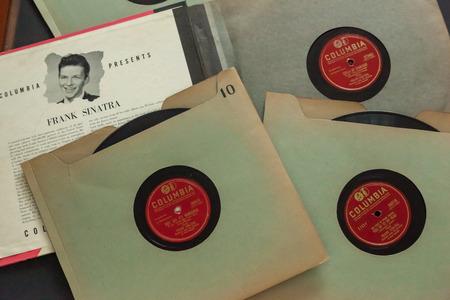WOODBRIDGE, NEW JERSEY - October 11, 2018: 1940s era Frank Sinatra 78 RPM records on a black background.