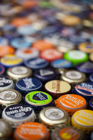 WOODBRIDGE, NEW JERSEY - October 13, 2018: A collection of colorful beer bottle caps of different brands is seen