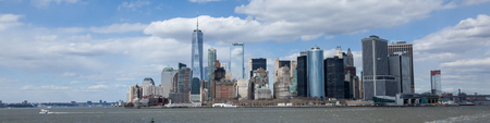 NEW YORK, NEW YORK - April 5, 2018: A panoramic view of the Lower Manhattan skyline from the Staten Island Ferry