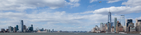 NEW YORK, NEW YORK - April 5, 2018: A panoramic view of the Lower Manhattan and Jersey City skylines from the Staten Island Ferry Sajtókép