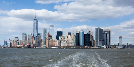 NEW YORK, NEW YORK - April 5, 2018: A view of the Lower Manhattan skyline from the Staten Island Ferry