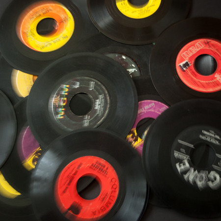 WOODBRIDGE, NEW JERSEY - October 11, 2018: A collection of 45 speed record albums, by various labels, done in an abstract blur