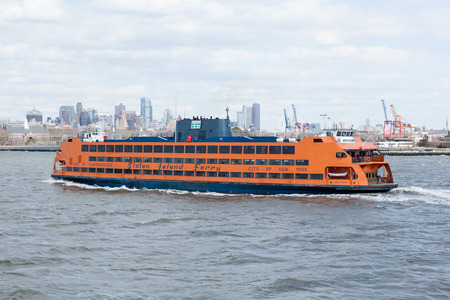 NEW YORK, NEW YORK - April 5, 2018: The Staten Island Ferry travels to Manhattan from St. Georges Terminal