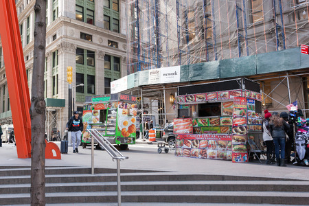 NEW YORK, NEW YORK - April 5, 2018: Street vendors sell their food and merchandise in Lower Manhattan