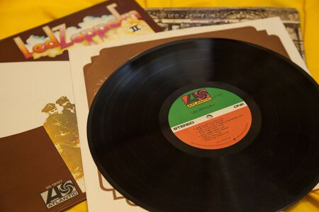 WOODBRIDGE, NEW JERSEY  UNITED STATES - January 16, 2020: A pile of vintage Led Zeppelin albums on a bright yellow background
