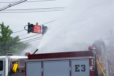 COLONIA, NEW JERSEY / UNITED STATES - June 6, 2015: Fire trucks from various towns participating in the2015 Colonia Fire Department wet down.