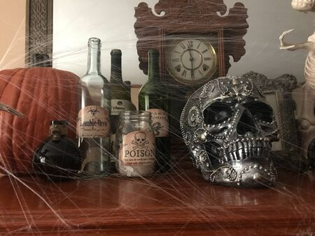 WOODBRIDGE, NEW JERSEY / UNITED STATES - October 5, 2018: Halloween decorations on display on a mantle in someone's home