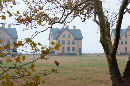 A view of the houses along Officers Row at Fort Hancock on a foggy autumn day. This is an inactive army military base on Sandy Hook, part of the Gateway National Recreation Area in New Jersey.