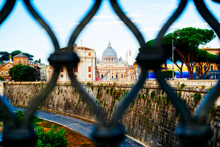 Italy, Rome, City of the Vatican dome of San Pietro seen from the bridge over the Tiber River