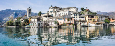 view of the island of San Giulio on Lake Orta, one of the most romantic lakes in Europe Stock Photo