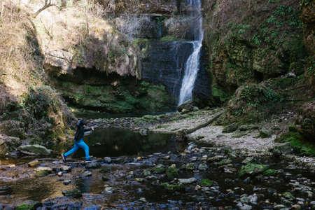 12 year old boy walking near Fermona waterfall Ferrera, Italy Stock Photo