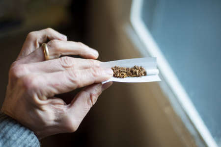 Hand with cigarette rolling