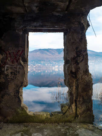 landscape of Lake Varese, through a broken wall,Varese,Lombardy,Italy Banque d'images