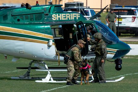October 12, 2019: Cocoa, Florida / USA - A Brevard County Sheriff's Office K9 Deputy and his four-legged partner demonstrate an apprehension from the air during the Space Coast Police K9 Competition. Archivio Fotografico - 132890770