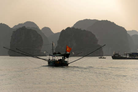 fishing boat halong bay Stock Photo