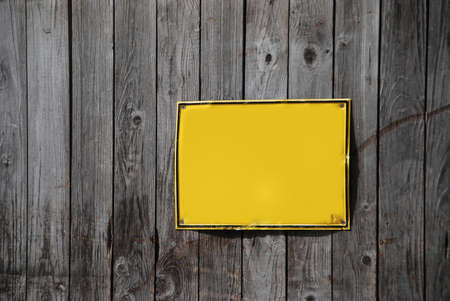 nobody: empty yellow sign on a wooden wall