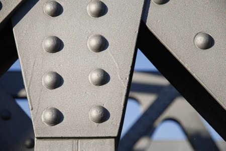 bridgework: Close-up of rivets of an iron bridge