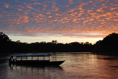 Boat in Sunrise Madre de dios in Peru