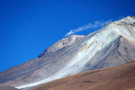 Smoking Volcano in in the desert of Bolivia