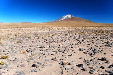 atacama: smoking volcano in the desert of bolivia Stock Photo
