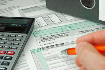 deduction: documents for income tax return Stock Photo