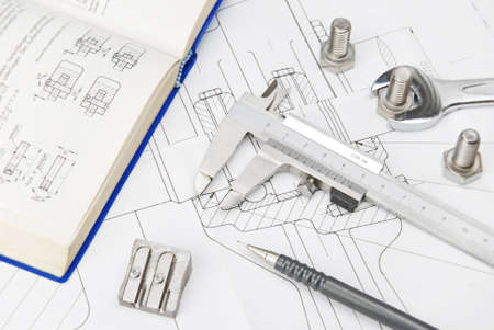 Caliper and book on technical drawing
