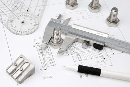 technical university: nuts wrench and caliper on technical drawing Stock Photo