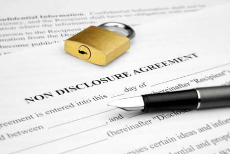 confidentiality: Non disclosure agreement with lock and pen Stock Photo