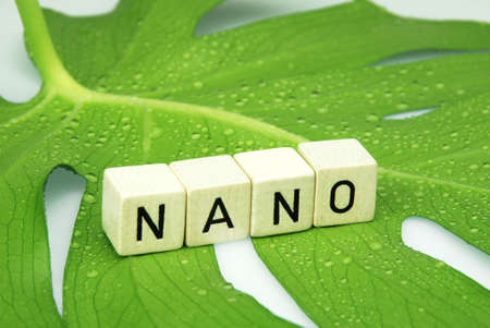 nano: green tropical leaf with water drops with lotus effect