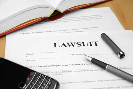lawsuit form with pen and cell phone Stock Photo - 12173486