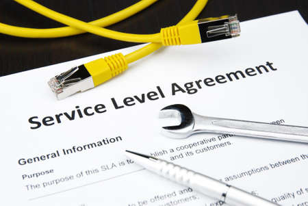web service: service level agreement with wrench, pen and lan cable Stock Photo