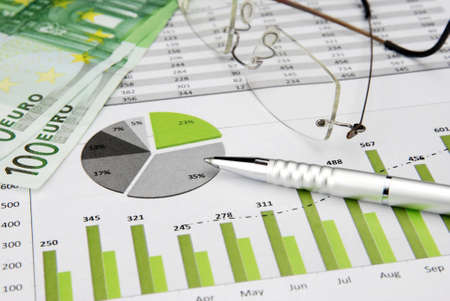 financial targets: green Business Charts Green with calculator, Euro Money, Glasses and pen Stock Photo