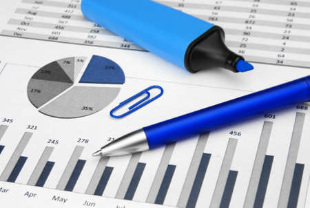 blue Business Charts calculator with marker pen Stock Photo