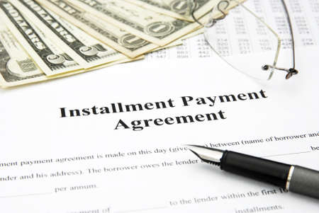 installment payment agreement document with glasses and filler