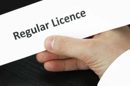 regular: Regular licence sign with hand Stock Photo