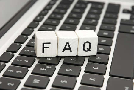 FAQ frequently asked questions sign symbol an a laptop keyboard Stock Photo