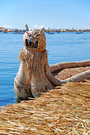 floating island lake titicaca with a dragon boat uro Stock Photo