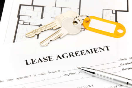 rent: Lease agreement document with keys and pen