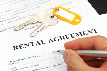 rental agreement form with signing hand and keys and pen Standard-Bild