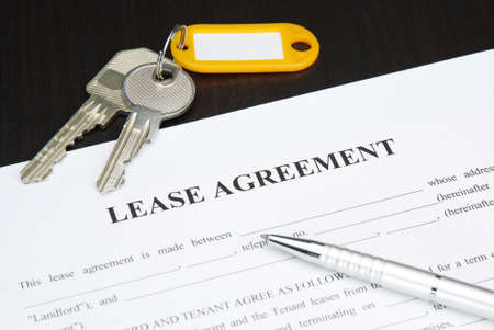 lease: Lease agreement document with keys and pen