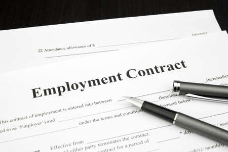 employment contract document form with pen