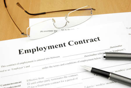 signing a contract: employment contract form with glasses and pen Stock Photo