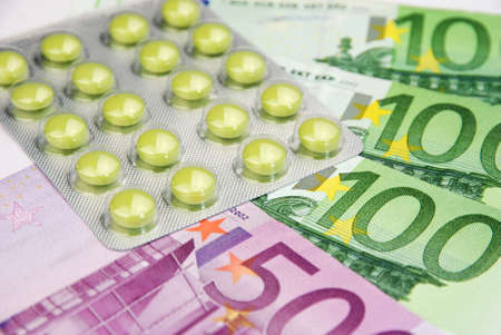expensive healthcare system with pills and money