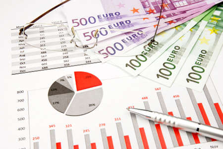 Business Finance Chart red with Money, pen and glasses Stock Photo