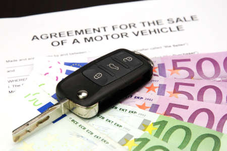 agreement document contract for sale of a motor vehicle with car key and money Stock Photo - 16103444