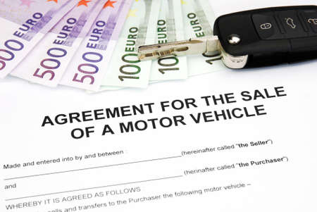 agreement document contract for sale of a motor vehicle with car key and money Stock Photo - 16103451