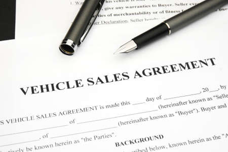 Vehicle Sales agreement document form with pen